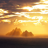 Golden Sunset at Skelligs, County Kerry, Ireland / skm0001 ****** <br /> <br /> Visit & browse through my Photography & Art Gallery, located on the Wild Atlantic Way & Skellig Ring between Waterville and Ballinskelligs (Skellig Coast R567), only 3 minutes from the main Ring of Kerry road.<br /> https://goo.gl/maps/syg6bd3KQtw<br /> <br /> ******<br /> <br /> Contact: 085 7803273 from an Irish mobile phone or +353 85 7803273 from an international mobile phone