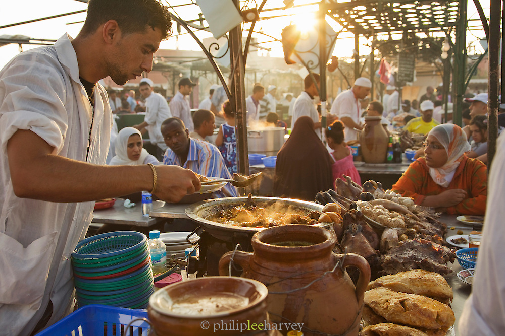 A chef preparing food at a stall in the Djemaa el Fna in the medina of Marrakech, Morocco. Every night the main square fills with dozens of food vendors and their carts