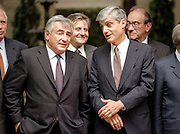 US Treasury Secretary Robert Rubin (right) talks with French Minister of Economy and Finance Dominique Strauss-Kahn during a group photo in the courtyard at Blair House October 3, 1998 in Washington, DC.