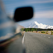 Touring car in Mt Cook National Park, Canterbury, Southern Alps, South Island, New Zealand.