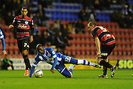 Wigan's  Marc Antoine Fortune is sent flying by QPR's Richard Dunne.   Skybet championship match, Wigan Athletic  v Queens Park Rangers at the DW Stadium in Wigan, Lancs on Wed 30th Oct 2013. pic by Andrew Orchard, Andrew Orchard sports photography,