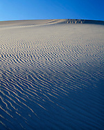 CADDV_014 - USA, California, Death Valley National Park, Ripple patterns in sand dunes at Mesquite Flats are defined by late afternoon light.