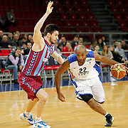 Anadolu Efes's Alfred Jamon Lucas (R) during their BEKO Basketball League match Anadolu Efes between Trabzonspor at Abdi Ipekci Arena in Istanbul Turkey on Sunday 23 February 2014. Photo by Aykut AKICI/TURKPIX