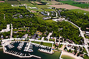 Aerial view of Sister Bay, Door County, Wisconsin; Al Johnson's Swedish Restaurant can be seen in the lower center portion of the photograph (grass roofed building).