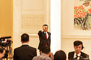 Chinese premier Li Keqiang waves to the media as he walks into his press conference on the closing day of the 12th National Peoples Congress NPC at the Great Hall of the People in Beijing, China, on Wednesday, March 16, 2016.