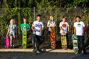 Wadebridge youngsters line up to skate and scoot in Lidl car park. WREN community energy has given funding received from the Feed in tariff from their solar array to a project that build a local skate park within the town. Wadebridge, Cornwall. UK