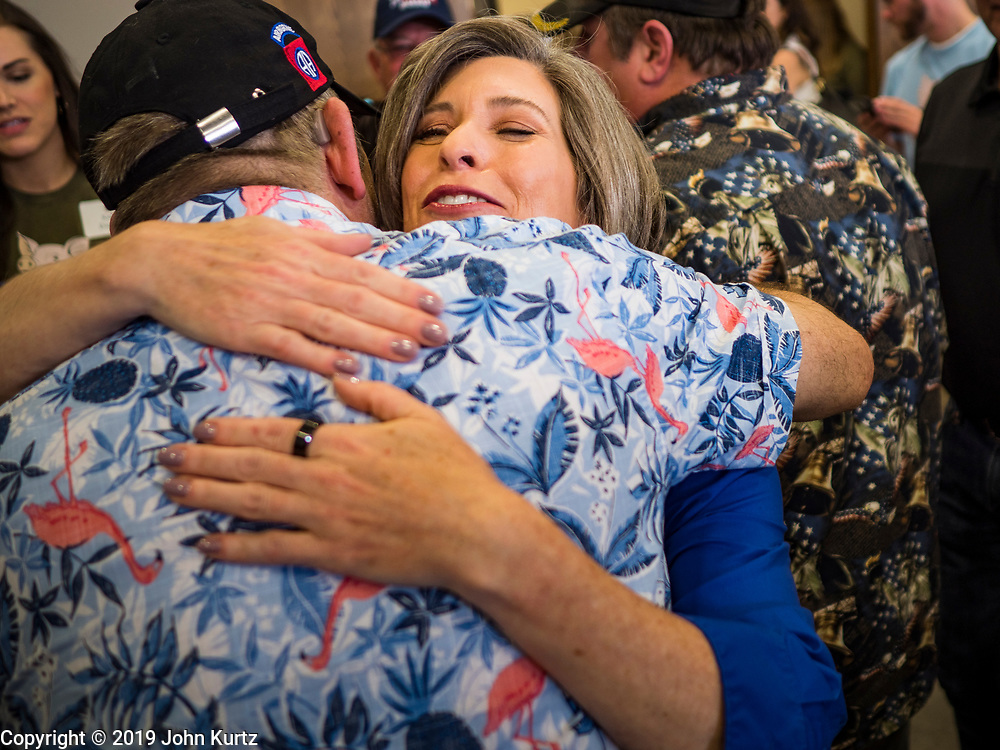 "15 JUNE 2019 - BOONE, IOWA: US Senator JONI ERNST (R-IA) hugs a supporter at ""Joni's Roast and Ride,"" a motorcycle ride / fund raiser hosted by Ernst. Ernst, Iowa's junior US Senator, kicked off her re-election campaign during the ""Roast and Ride"", an annual fund raiser and campaign event has she held since originally being elected to the US Senate in 2014.    PHOTO BY JACK KURTZ"