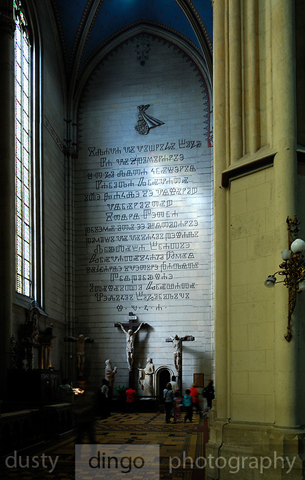 """Ancient Croatian Glagolitic script, or Glagolitsa, above representation of the 12th Station of the Cross, """"Calvary"""", by sculptor Ante Orlic. Zagreb Cathedral of the Assumption of the Blessed Virgin Mary, Zagreb, Croatia"""