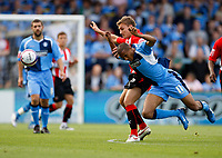 Photo: Richard Lane/Richard Lane Photography. Wycombe Wanderers v Brentford. Coca Cola Fotball League Two. Brentford's Craig Pead and Wycombe's Chris Zebroski (11) challenge for the ball.