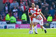 Matty Blair of Doncaster Rovers (17) scores a goal and celebrates to make the score 1-2 during the EFL Sky Bet League 1 play off first leg match between Doncaster Rovers and Charlton Athletic at the Keepmoat Stadium, Doncaster, England on 12 May 2019.