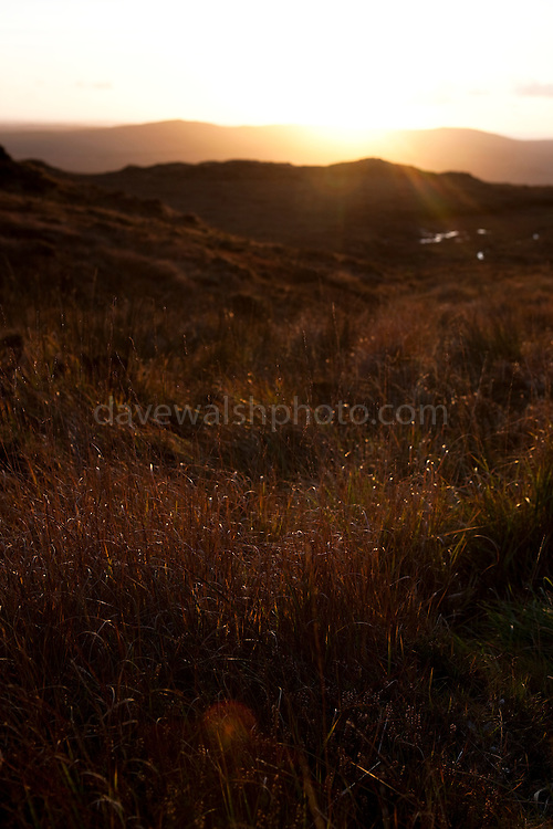 Sunset seen from Diamond Hill, a mountain in the Twelve Bens (or Pins) range, part of Connemara National Park, Galway, Ireland