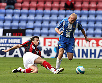 Photo: Sportsbeat Images.<br />Wigan Athletic v Fulham. The FA Barclays Premiership. 15/09/2007.<br />Fulham's Simon Davies (L) tackles Wigan's David Cotterill