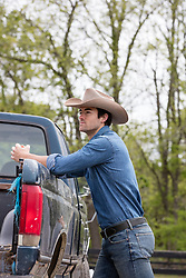 cowboy with a pick up truck on a ranch