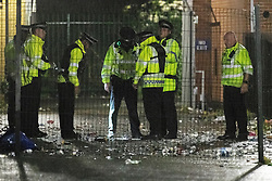© Licensed to London News Pictures. 21/06/2020. Manchester, UK. Police respond amid reports of a shooting at a street party in Moss Side in South Manchester in the early hours of this morning (Sunday 21st June 2020). Photo credit: Joel Goodman/LNP