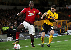Manchester United's Paul Pogba (left) and Wolverhampton Wanderers' Joao Moutinho battle for the ball during the FA Cup quarter final match at Molineux, Wolverhampton.