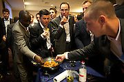 Executives learn cookery and teamwork at a corporate rally day, held for 3,000 UK staff at Excel, Docklands.