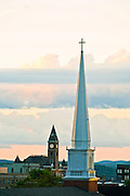 A church steeple and courthouse steeple at sunrise in Fayetteville, Arkansas.
