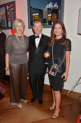 Left to right, The Home Secretary THERESA MAY MP, PHILIP MAY and BARONESS BRADY at a party to celebrate the 21st anniversary of The Roar Group hosted by Jonathan Shalit held at Avenue, 9 St.James's Street, London on 21st September 2015.