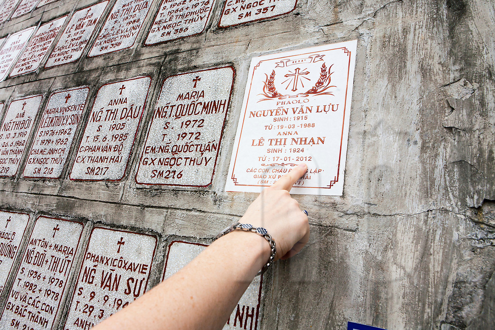 Wall of plaques that line the ramp up the hill to the Cathedral of Nha Trang, Vietnam, Southeast Asia