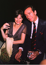 MISS MIRANDA DAVIS and the HON.ROBERT HANSON son of Lord Hanson, at a party in London on 9th July 1998.MJA 91