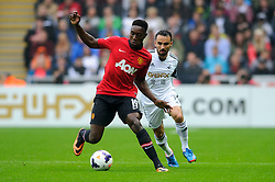 Man Utd Forward Danny Welbeck (ENG) is challenged by Swansea Midfielder Leon Britton (ENG) during the first half of the match - Photo mandatory by-line: Rogan Thomson/JMP - Tel: Mobile: 07966 386802 17/08/2013 - SPORT - FOOTBALL - Liberty Stadium, Swansea -  Swansea City V Manchester United - Barclays Premier League - First round of the 2013/14 season and the first league match for new Man Utd manager David Moyes.