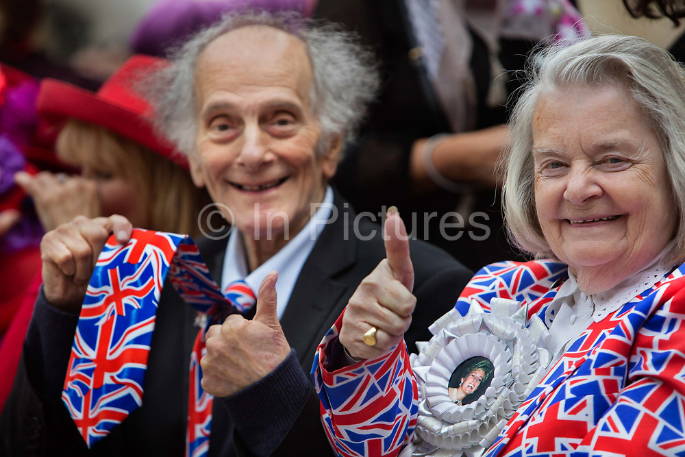 Staunch royalists David Jones & Margeret Tyler attending the Pearly Kings and Queens Harvest Festival celebrations at Guildhall Yard. The annual event features early English entertainment including maypole dancing, Morris dancers and a marching band. The Chelsea pensioners & all the mayors of London take part in this traditional London event.<br /> The London tradition of the Pearly Kings and Queens began in 1875, by Henry Croft. Inspired by the local Costermongers, a close-knit group of market traders who looked after one another and were recognisable by buttons sewed onto their garments, Henry went out on the streets to collect money for charity, wearing a suit covered in pearl buttons to attract attention. When demand for his help became too much, Henry asked the Costermongers for assistance, many of whom became the first Pearly Families. Today, around 30 Pearly Families continue the tradition to raise money for various charities.