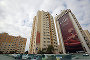 Advertising billboards on appartment buildings in Respubliki Avenue.