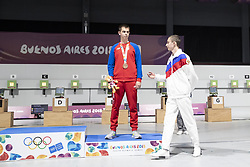 BUENOS AIRES, Oct. 8, 2018  Gold medalist Grigorii Shamakov (R) of Russia greets bronze medalist Aleksa Mitrovic of Serbia during the awarding ceremony of the Men's 10m Air Rifle Final at the 2018 Summer Youth Olympic Games in Buenos Aires, capital of Argentina, Oct. 7, 2018. (Credit Image: © Li Ming/Xinhua via ZUMA Wire)