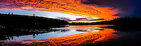 Sweden, Värmland, Sunset. Fire in the sky. Colourful sunset at a small lake in Värmland, not far from the Norwegian border. Panorama image.