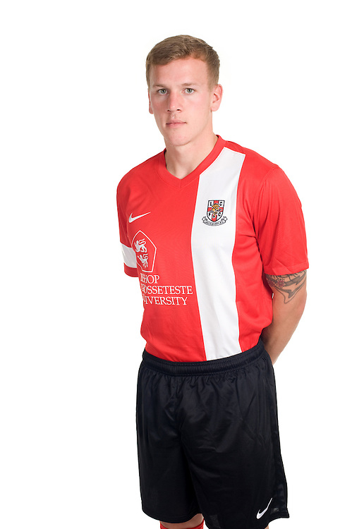 Lincoln City defender Tom Miller poses for photographs as part of Lincoln City's 2013/14 kit launch<br /> <br />  (Photo by Chris Vaughan/CameraSport) <br /> <br /> Commercial - Lincoln City Kit Launch - Monday 29th July 2013 - Sincil Bank - Lincoln<br /> <br /> © CameraSport - 43 Linden Ave. Countesthorpe. Leicester. England. LE8 5PG - Tel: +44 (0) 116 277 4147 - admin@camerasport.com - www.camerasport.com