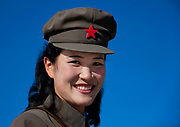 Fashion in North Korea<br /> <br /> In every corner of the earth, women love to look beautiful and keep up with the latest fashion trends. The women of North Korea are no different. Fashion is taken seriously here. But in North Korea, women do not read Elle or Vogue; they just glimpse a few styles by watching TV or by observing the few foreigners who come to visit. In the hermit kingdom, clothing also reflects social status. If you have foreign clothes it means you travel and are consequently close to the centralized power. Chinese products have inundated the country, adding some color to the traditional outfits that were made of vynalon fiber. But citizens beware, too much style means you're forgetting the North Korean juche, the ethos of self-reliance that the country is founded on! But the youth tend to neglect it despite the potential consequences.<br /> <br /> Photo shows: The cap is an integral part of the fashion in North Korea. Almost all the uniforms include it. Here, a tour guide can be seen wearing it. It is worn very high on the top of the head and gives a unique look!<br /> ©Eric Lafforgue/Exclusivepix Media