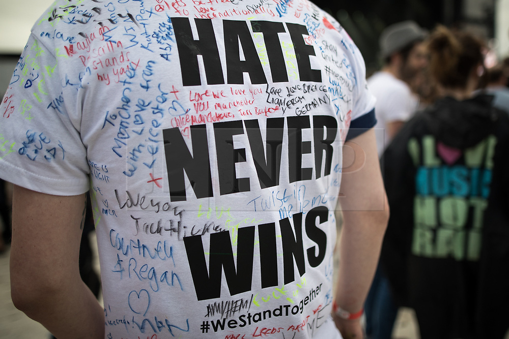 """© Licensed to London News Pictures . 27/05/2017 . Manchester , UK . Man with """" HATE NEVER WINS """" t-shirt amongst the crowd at the stadium . Manchester music line up , featuring Courteeners , Charlatans , Blossoms and Cabbage , at the Emirates Old Trafford Stadium . Photo credit : Joel Goodman/LNP"""