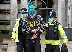 """© Licensed to London News Pictures;07/04/2021; Bristol, UK. A man is arrested for urinating by the front door of BBC Bristol at a sixth """"Kill the Bill"""" protest outside the BBC offices in Bristol against the Police, Crime, Sentencing and Courts Bill during the Covid-19 coronavirus pandemic in England. This protest is billed as """"Stand up against a police state and against a biased media"""" and the protest is due to march from College Green in the city centre to the offices of BBC Bristol on Whiteladies Road. Some protesters say that the media is biased. The Police, Crime, Sentencing and Courts Bill proposes new restrictions on protests. Some previous Kill the Bill protests in Bristol had violence. Photo credit: Simon Chapman/LNP."""