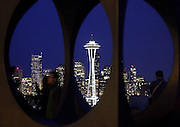"""The Space Needle is seen through the sculpture """"Changing Form"""" by Doris Chase during twilight in Seattle. (Erika Schultz / The Seattle Times)"""