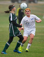 Newfound's Cian Connor and Gilford's Ben Gardiner charge the ball during second round tournament play for NHIAA Division III soccer on Thursday afternoon.  (Karen Bobotas/for the Laconia Daily Sun)