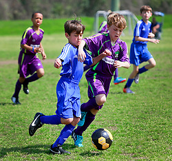 15 March 2015. New Orleans, Louisiana.<br /> U9 New Orleans Jesters Elites, Purple team Game 2 against Gonzales Soccer Club.Jesters emerge victorious with a 6-2 win.<br /> Photo; Charlie Varley/varleypix.com