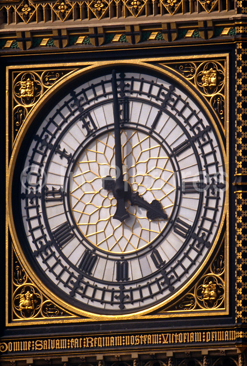 A detail of the clock face to the Elizabeth Tower in London. It's close to 4pm and we see the hands and neo-Gothic design. The Elizabeth Tower (previously called the Clock Tower) named in tribute to Queen Elizabeth II in her Diamond Jubilee year – was raised as a part of Charles Barry's design for a new palace, after the old Palace of Westminster was largely destroyed by fire on the night of 16 October 1834. The new Parliament was built in a Neo-gothic style. Although Barry was the chief architect of the Palace, he turned to Augustus Pugin for the design of the clock tower. It celebrated its 150th anniversary on 31 May 2009. The tower was completed in 1858 and has become one of the most prominent symbols of both London and England,
