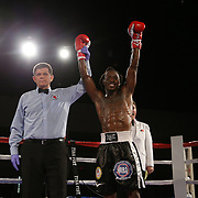 John Cooley fights Joseph Cole during a Fire Fist Boxing Promotions boxing match at the A La Carte Pavilion on Saturday, August 12 , 2017 in Tampa, Florida.  (Alex Menendez via AP)
