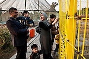 A family visits the Al Zawraa' Gardens Zoo in Baghdad.