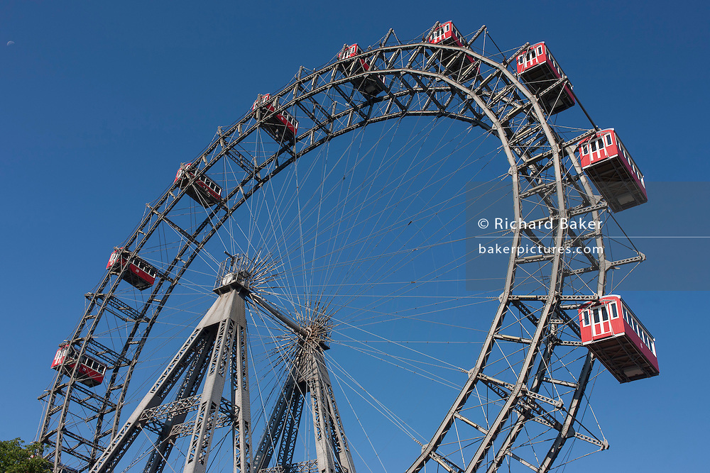 The 64.75-metre tall Wiener Riesenrad Ferris wheel in Prater amusement park in Leopoldstadt, the 2nd district of Vienna, Austria, EU. Constructed in 1897, it was the world's tallest extant Ferris wheel from 1920 until 1985 and is one of Vienna's most popular tourist attractions.