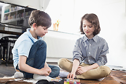 Girl and boy playing board game