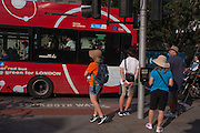 Hot pedestrians and bus passengers during an unusual autumn heatwave on 13th September 2016, in the City of London, England.