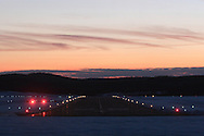 Montgomery, NY - A runway with the runway lights on at sunset at Orange County Airport in Montgomery on March 2, 2008.