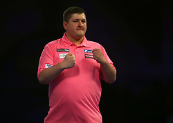 Keegan Brown celebrates winning a set during his match against Karel Sedlacek during day three of the William Hill World Darts Championships at Alexandra Palace, London.