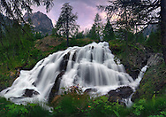 This is one of my favourite places in the entire Alps range: the falls of the river Gesso in the Alpi Marittime natural park. I took this picture on a evening of mid June around sunset. A wonderful soft light spreading through the clouds of an approaching storm contributed to the scene a subtle ethereal look. This is a stitch of five vertical frames.