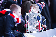 A young fan's foil FA Cup trophy during the The FA Cup fourth round match between Doncaster Rovers and Oldham Athletic at the Keepmoat Stadium, Doncaster, England on 26 January 2019.