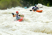 PRICE CHAMBERS / NEWS&GUIDE<br /> Libby Crowley, left, and Joe Larrow navigate a raging Grey's River as they drop into a class IV rapid called Snaggletooth on Sunday. The final event of the Wyoming Whitewater Championships, the kayak boatercross tests the skills of even the most seasoned paddlers.