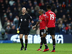 Manchester United's Marcus Rashford gets a yellow card from Referee Anthony Taylor