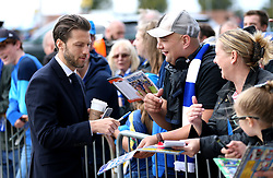 Cardiff City's Harry Arter signs autographs for fans as he arrives at the Stadium before the match begins