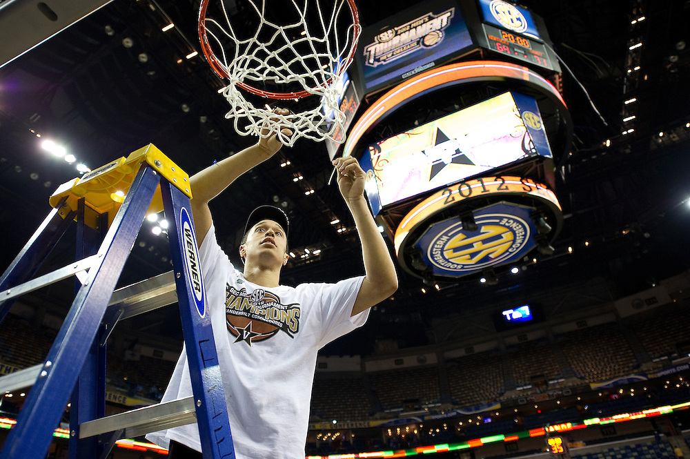 New Orleans , LA. - Game 11 of the 2012 SEC Men's Basketball Tournament between Kentucky and Vanderbilt, was played Monday, March 12, 2012 at the New Orleans Arena. Vanderbilt guard John Jenkins cuts down a portion of the net after his team won the 2012 SEC Championship and he was named tournament MVP.